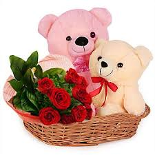 2 teddy bears (6 inches each) with 8 red roses in same basket