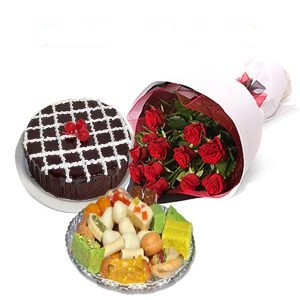 Half Kg Mix Barfi with 1/2 Kg Chocolate Cake and 12 Red roses bouquet