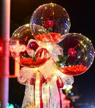 3 Red rose in 3 transparent balloon red white wrapping arrangement Only for Pune