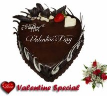 1 Kg chocolate truffle heart shaped cake with 5 roses
