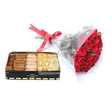 1/2 Kg Sweets and Bunch of 6 Red roses