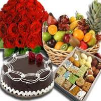 Half Kg Mix Barfi with 1/2 Kg Chocolate Cake and 12 Red roses bouquet 2 kg Fresh fruits basket