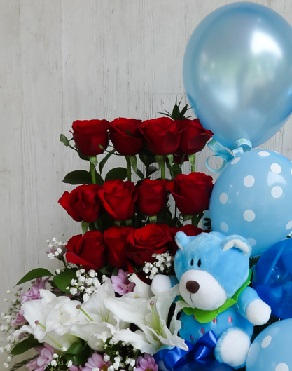 12 Red Roses 4 White lilies with Blue Teddy and 4 Blue Balloons arranged in a basket