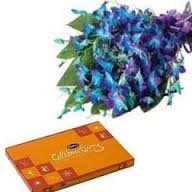 Celebration Chocolates and 10 Blue orchids bouquet