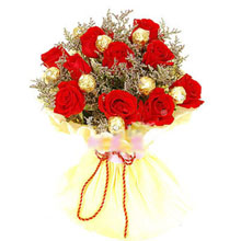 6 Ferrero and 8 red roses in a bouquet