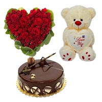 8 to 10 inches Teddy bear with Half Kg chocolate cake and 20 Red roses Heart