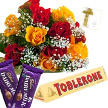 6 Red 6 Yellow Roses bouquet with 2 Dairy Milk and 1 Toblerone chocolate