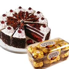 1/2 kg chocolate cake, a box of ferreo roche chocolates