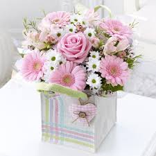 Pink Flowers In A Gift Bag