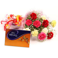 Assorted flowers with chocolate box