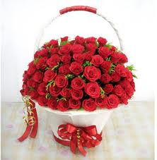 Roses arranged in a basket.