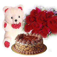 1/2 kg Cake with 12 red roses and teddy