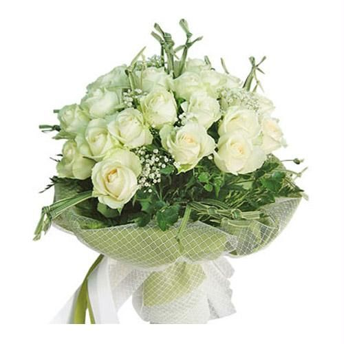 24 White roses arranged in a vase