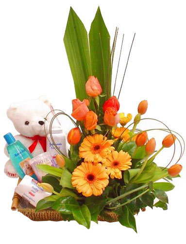 Teddy bear ,flowers and johnsons baby kit