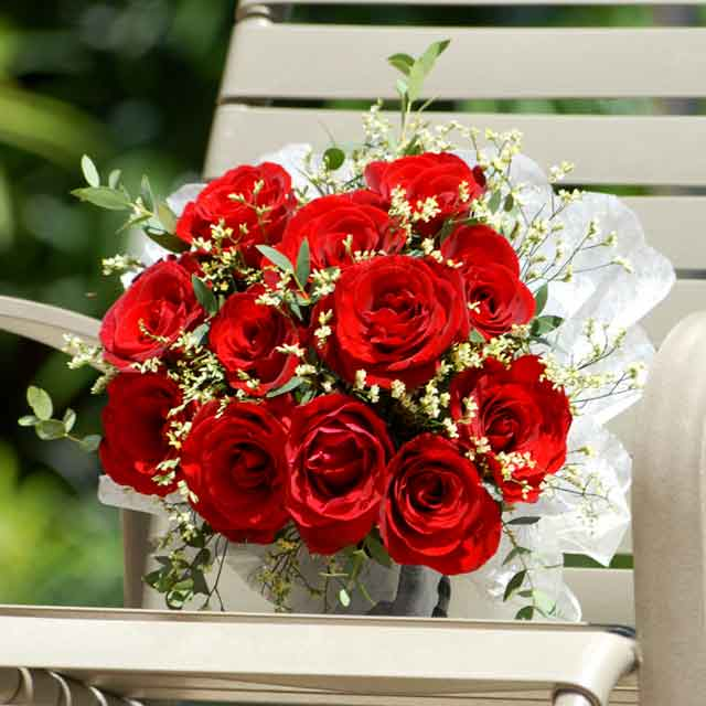 2 dozen red roses in a bunch