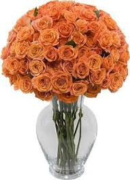 36 orange roses in a glass vase
