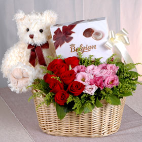 Assorted chocolate box, 15 red roses basket, 1 feet Teddy