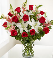 Lilies and red roses in a vase