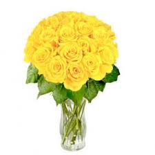 24 yellow roses in a glass vase