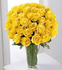 36 yellow roses in a glass vase