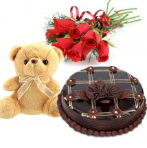 5 Red Roses 1/2 Kg Dark chocolate Cake and Teddy (6 Inches)