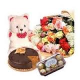 Flowers, cake, teddy bear and chocolates