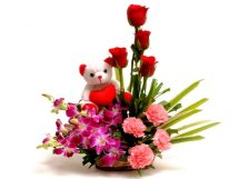 6 Red Roses 4 Pink Carnations 5 Purple orchids with 6 inches Teddy in a Basket