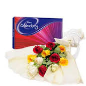 Bouquet of mixed flowers with box of Cadbury celebration