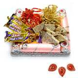 Hand made chocolates with kaju katli in a decorated tray