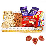 Cashews and almonds in a decorated tray with chocolates