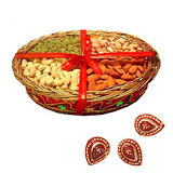 Dry fruit in a basket with 3 diyas