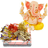 An assortment of sweets with chocolates and Ganesh idol