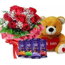 Arrangement of 12 roses basket 4 silk chocolates with teddy