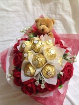 10 Red Roses with 5 ferrero and 1 teddy bear (6 inches each)in same bouquet
