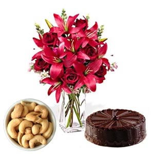 6 lilies in a vase with 200 gm cashews and 1 kg chocolate cake