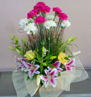 Carnations and Lilies in a basket