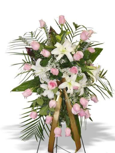 An arrangement with Pink white lilies