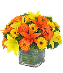 Yellow and orange lilies in a basket