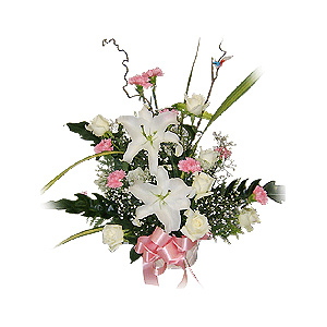 White lilies, pink carnations and white roses in basket arrangement