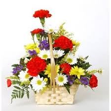 Dozen mixed assorted flowers in a hand woven basket