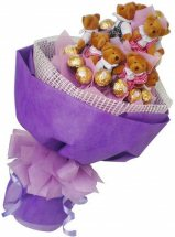 16 ferrero 7 Teddy bears(6 inches each)in same bouquet with purple wrapping