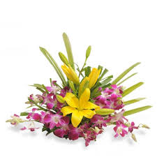 Yellow lilies and orchids in a basket