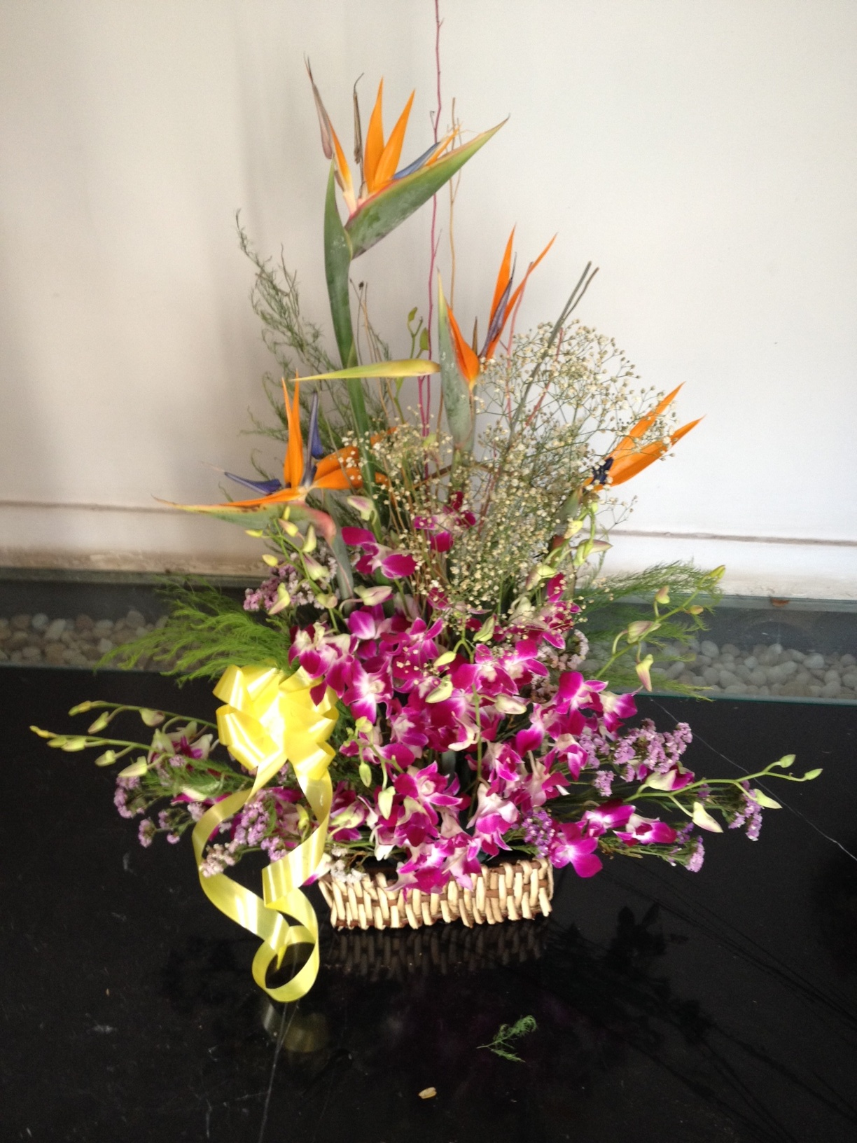 Bird of paradise and orchids basket