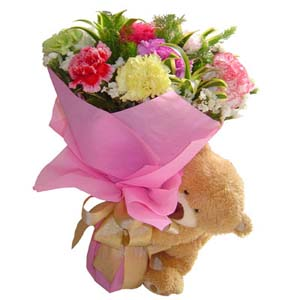 Assorted flowers with teddy