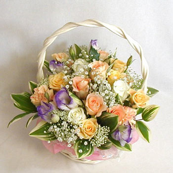 An arrangement of 12 mix roses basket