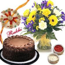Flowers and cake with rakhi