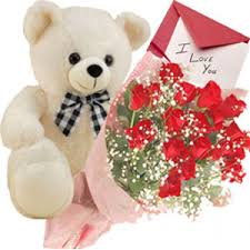 Dozen red roses with teddy and card
