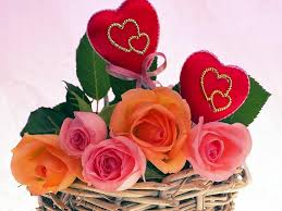 2 Hearts (3 to 4 inch each) 5 pink orange Roses in same basket