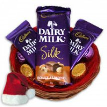 3 Cadburys Silk chocolates in a basket