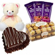 3 Cadburys Silk chocolates with Teddy 1 Kg chocolate Heart cake and 16 Ferrero rocher chocolates